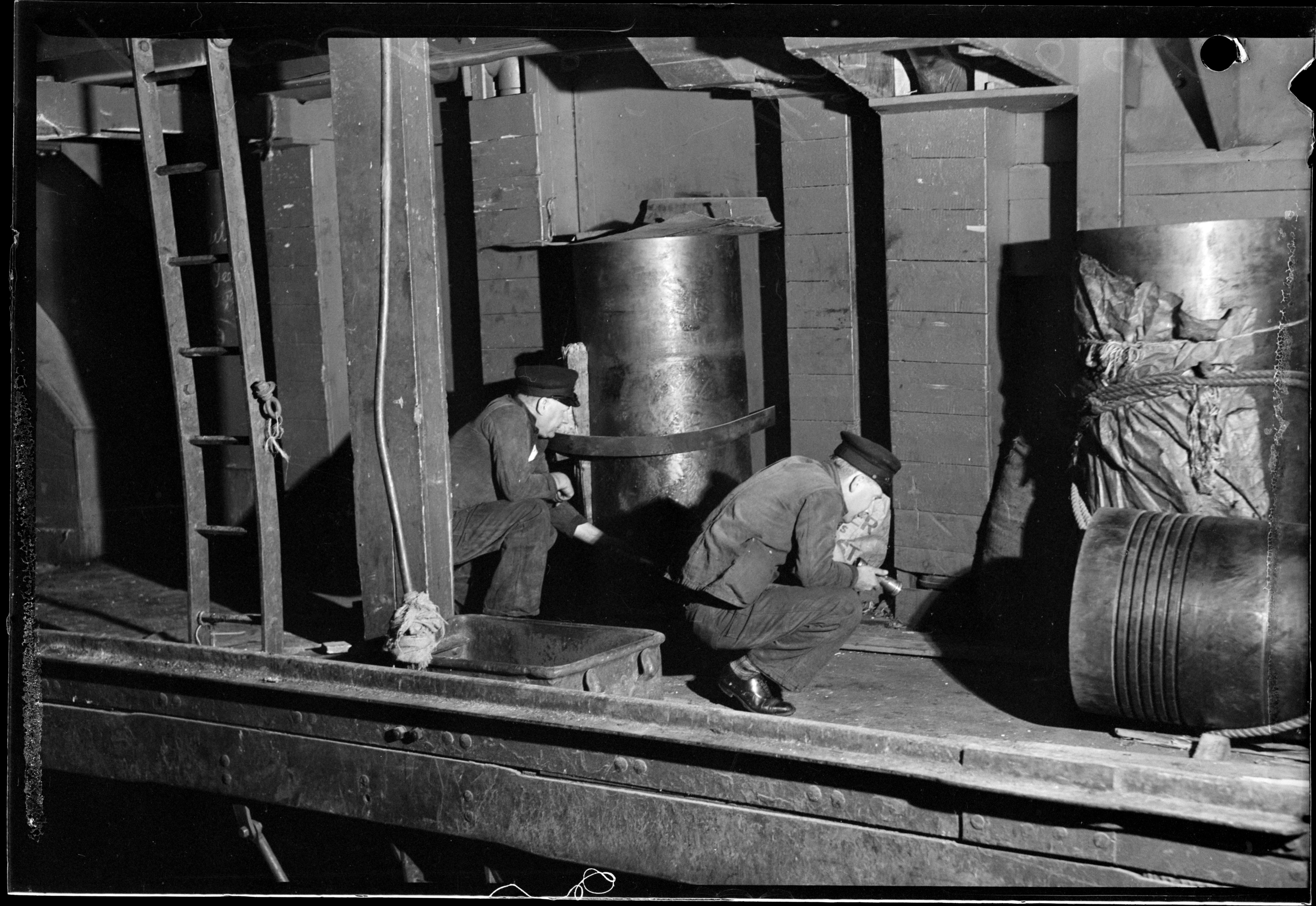 Rat exterminators searching wharves at night 24 October 1941