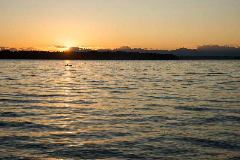 Man kayaking during sunset at Seahurst Park, Burien, WA