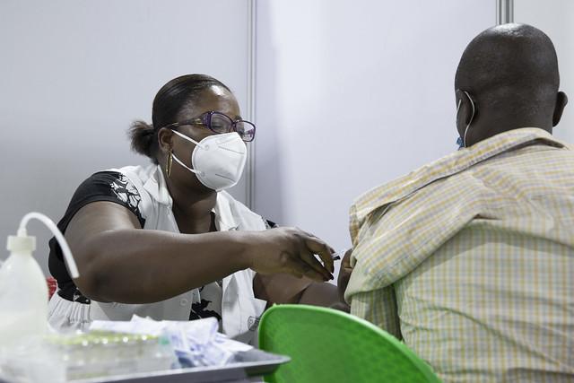 Healthcare worker provides COVID-19 vaccination