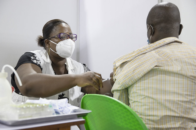 Healthcare worker provides vaccination
