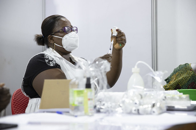 Healthcare worker prepares COVID-19 vaccination for patient