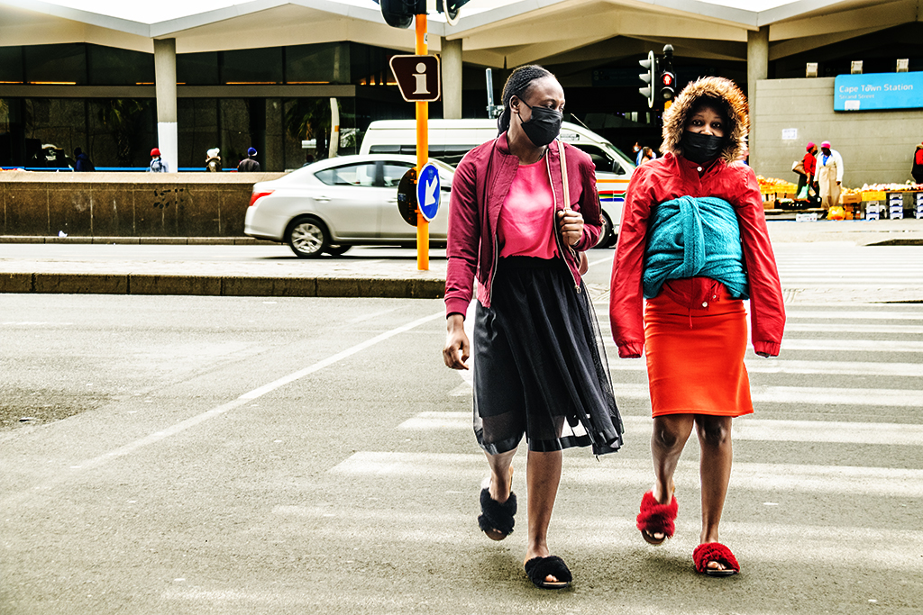 Two young women crossing Strand on 9-4-21--Cape Town