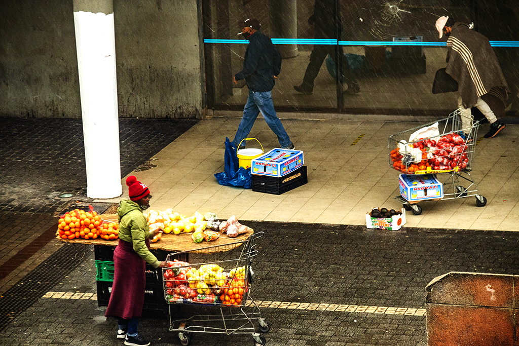 Woman selling fruits outside train station on 9-5-21--Cape Town