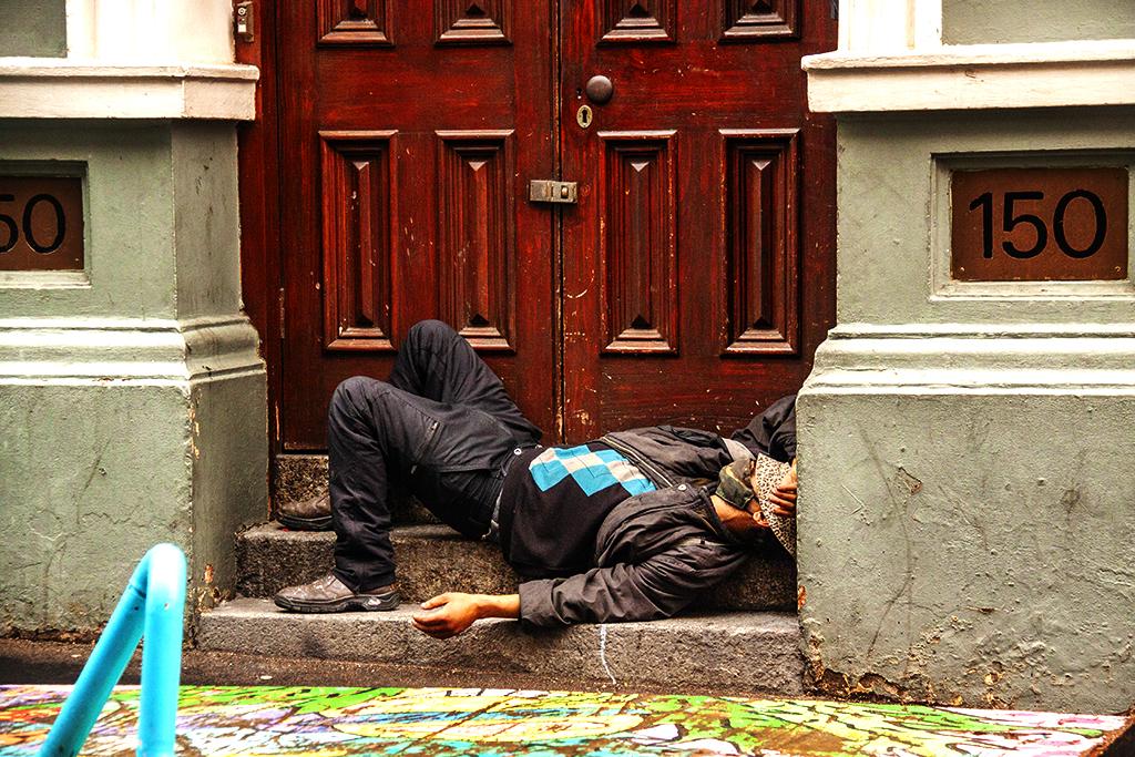 Homeless man sleeping on Longmarket on 9-3-21--Cape Town