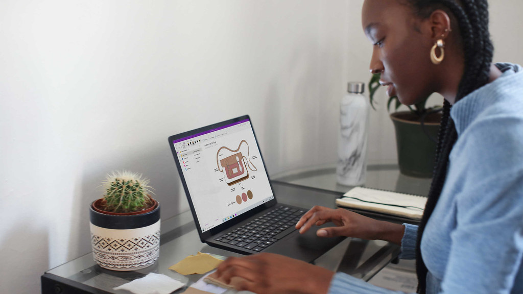 A person on a laptop in a home office