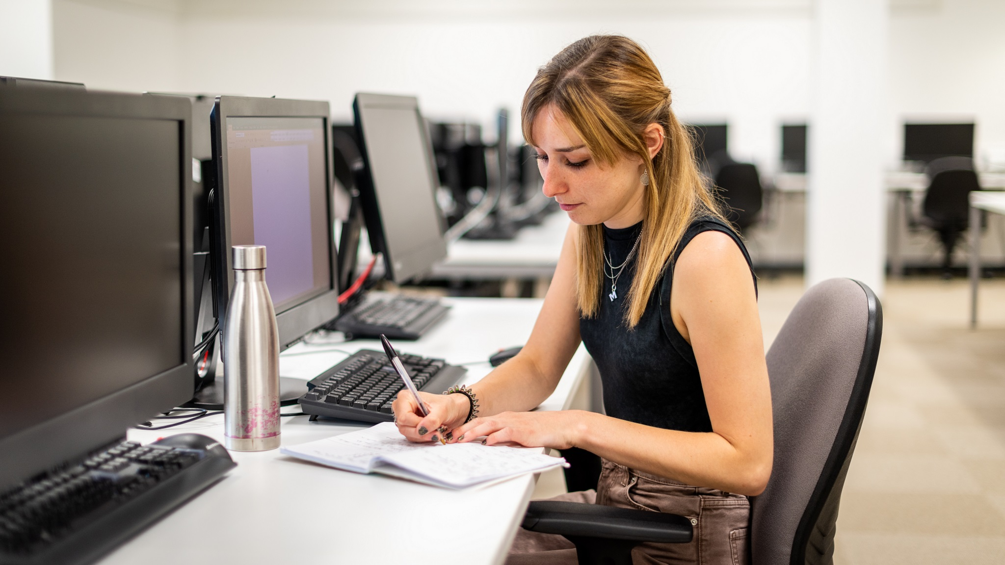 Student working at a workstation on campus.