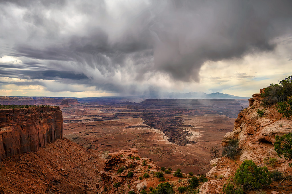 Rainstorm over the canyons at Grand View Point Overlook, Canyonlands National Park, Moab, Utah