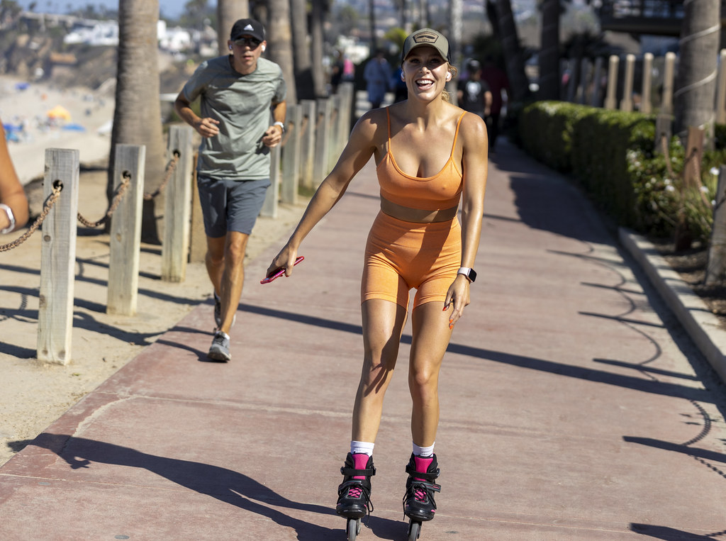Woman in orange outfit rollerblading