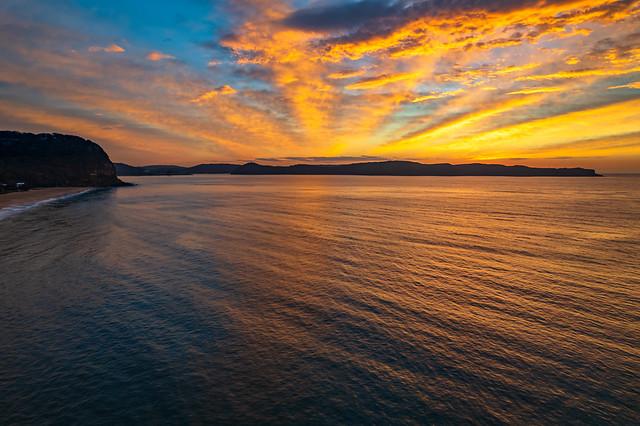 High Cloud Sunrise Seascape with Soft Shades of Colour