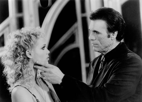 Elizabeth Berkley and Robert Davi in Showgirls (1995)