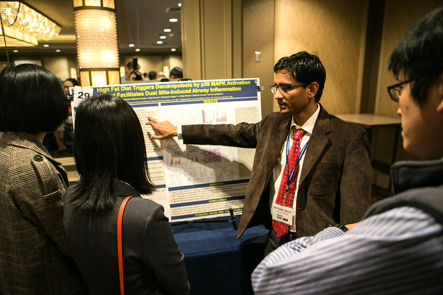 Previous Boshell event attendees view research posters.