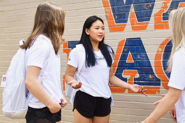 Sunisa Lee is pictured walking on campus with friends