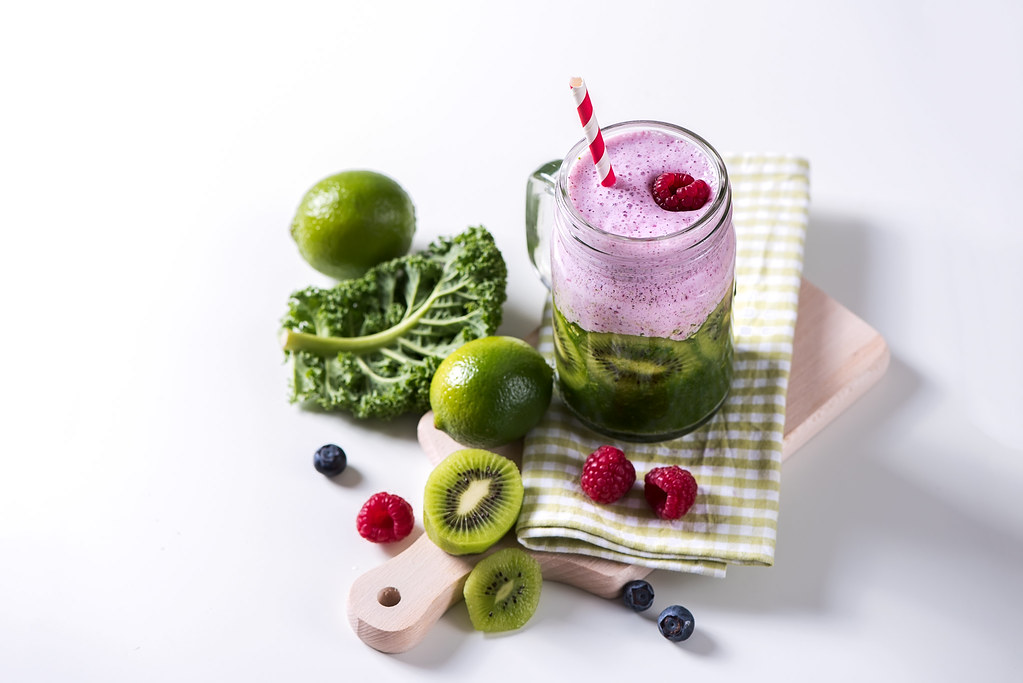 Green and red smoothie, healthy detox drink, diet or vegan food concept, vitamins, copy space white background