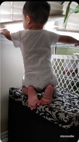 Back of baby on a high surface
