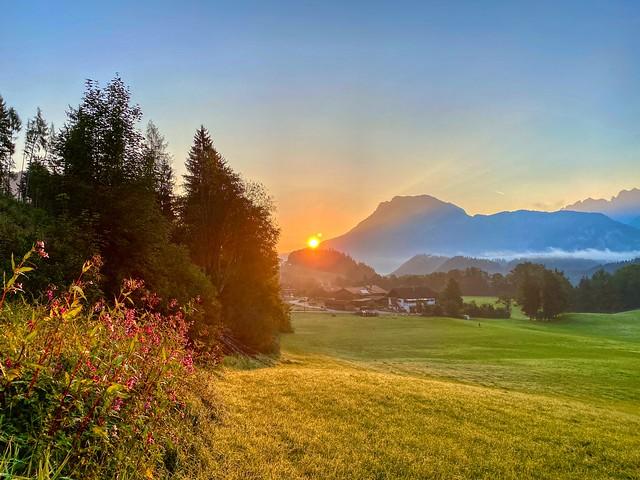 Sunrise over the river Inn valley with Zahmer Kaiser mountain range seen from Breitenau near Kiefersfelden in Bavaria, Germany