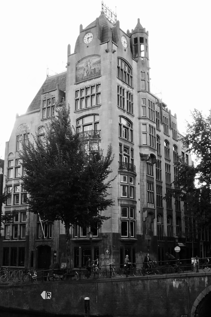 A beautiful tall and old building on the canal , gracht , photograph converted to black and white , Martin's photograph , Amsterdam , Noord Holland ; North Holland , Nederland ; the Netherlands , September 4. 2010