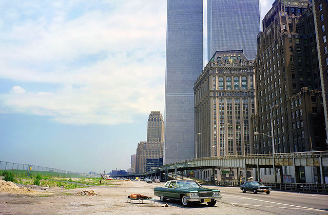 More Lower Manhattan adventures in the good old days. The swampy fields of future Battery Park City, a guy from New Jersey takes a snooze, The World Trade Center hovers and all is right with the world. New York. August 1976