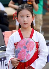 A very serious young Chinese girl performer