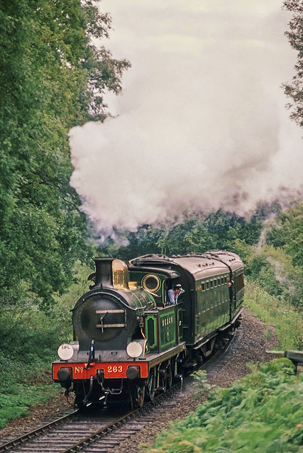 SE&CR H Class tank engine no. 263 hauls a short local passenger train into the cutting at Lindfield Wood