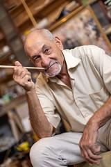 Artist, cartoonist, and poet Mojek Charyev, 76, in his Art studio in Ashgabat.