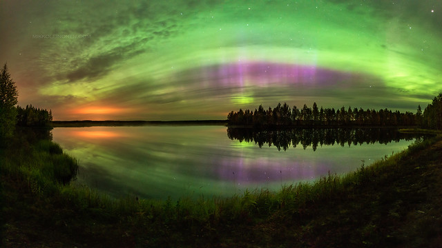 Clouds with green and pink auroras