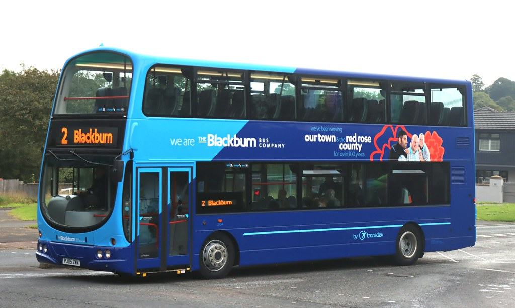 A nearside view of 2754 PJ05ZWA the first Blackburn Bus Company (Transdev Lancashire) decker in two tone blue fleet livery working a Blackburn bound service 2 at Whittle Springs near Chorley.