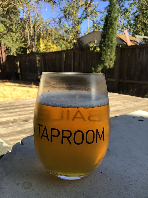 Block 15's Sticky Fingers IPA in glass, outside