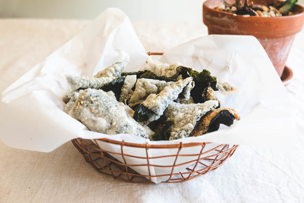 A photo of the rice paper fried seaweed in a basket lined with paper.
