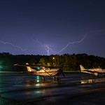 13. September 2021 - 21:10 - A bolt of lightning over a Cessna at Greenwood Lake Airport (4N1) in West Milford, New Jersey, USA.