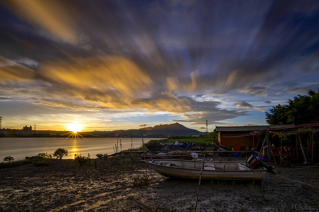 Houseboat at Low Tide During Sunset