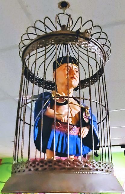 Alypius of Alexandria; imprisoned in birdcage