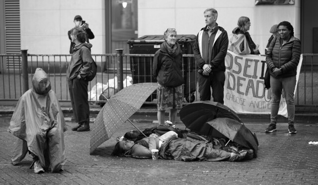 Despondent but determined outside the DSEI Arms Fair