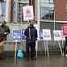 Activists and peace banners outside the DSEI Arms Fair