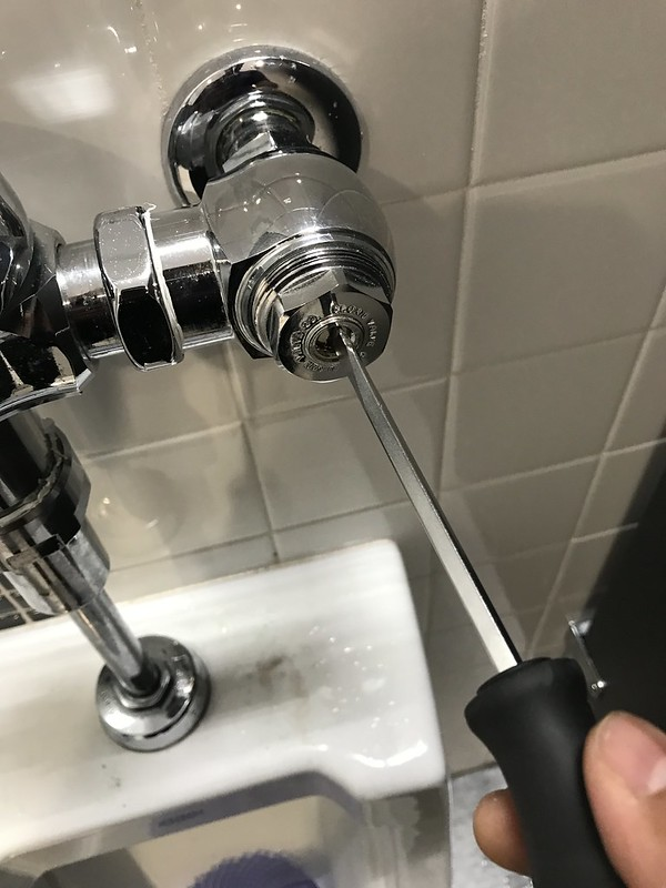 Use a screwdriver to turn water flow on/off
