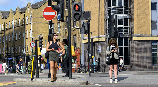 DSC_2097a Shoreditch London Old Street Attractive Lady in Green Skirt Black Top and Glasses Crossing the Road