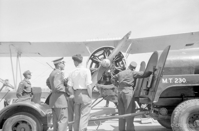 Ex-RNZAF Avro 626 ZK-APC (NZ203) attracts attention from RNZAF personnel while being refuelled at Woodbourne in the late 1950s