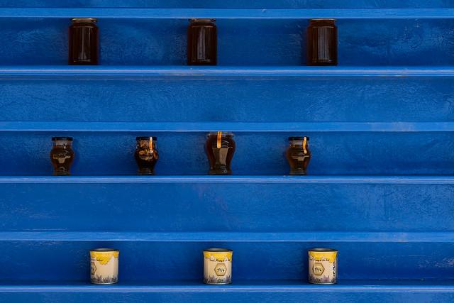 Blue greek cupboard with pots