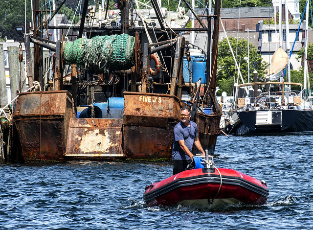 Fishing Boat--Man on Raft