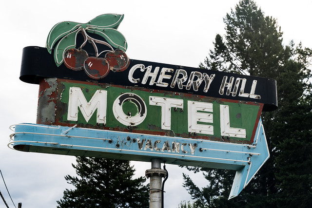 Polson, Montana - August 18, 2021: Retro neon sign for the Cherry Hill Motel in the Flathead Lake area