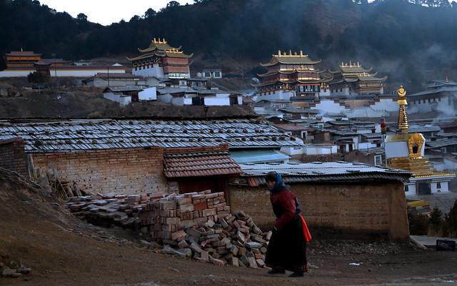 Smoke from the kitchens filled the morning air . Langmusi , Gansu , China .