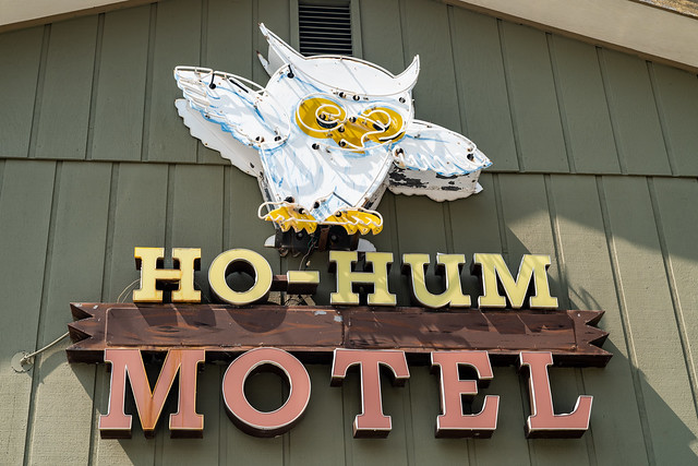 West Yellowstone, Montana - August 23, 2021: Classic neon sign featuring an owl at the Ho-Hum Motel, an option for lodging near the West Entrance of the national park