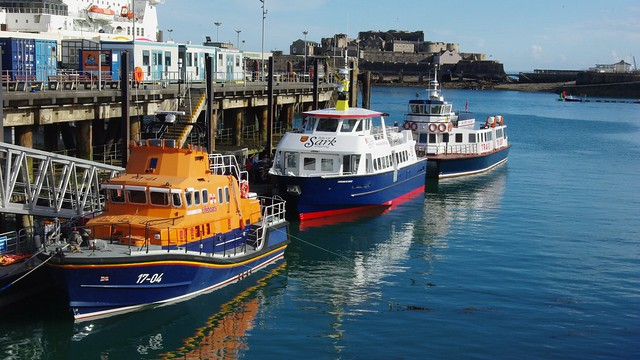 21-099  The Guensey Lifeboat and the Sark and Herm Ferries moored in St. Peter Port Harbour, Guernsey