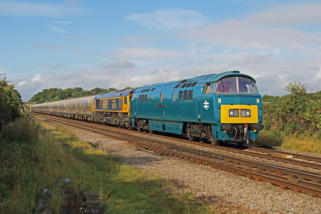 D1015 Western Champion on test, (with 66719) approaches Cam & Dursley Station working 6M42 AVONMOUTH HANSON SDG GBRF -  PENYFFORDD CEMENT GBRF as far as Gloucester 17-09-2021