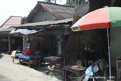 Large multicoloured umbrella on the edge - Luang Prabang Laos