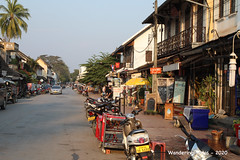 One yellow umbrella along the street - Luang Prabang Laos