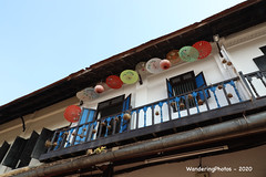 Decorative parasols under the roof eaves - Luang Prabang Laos