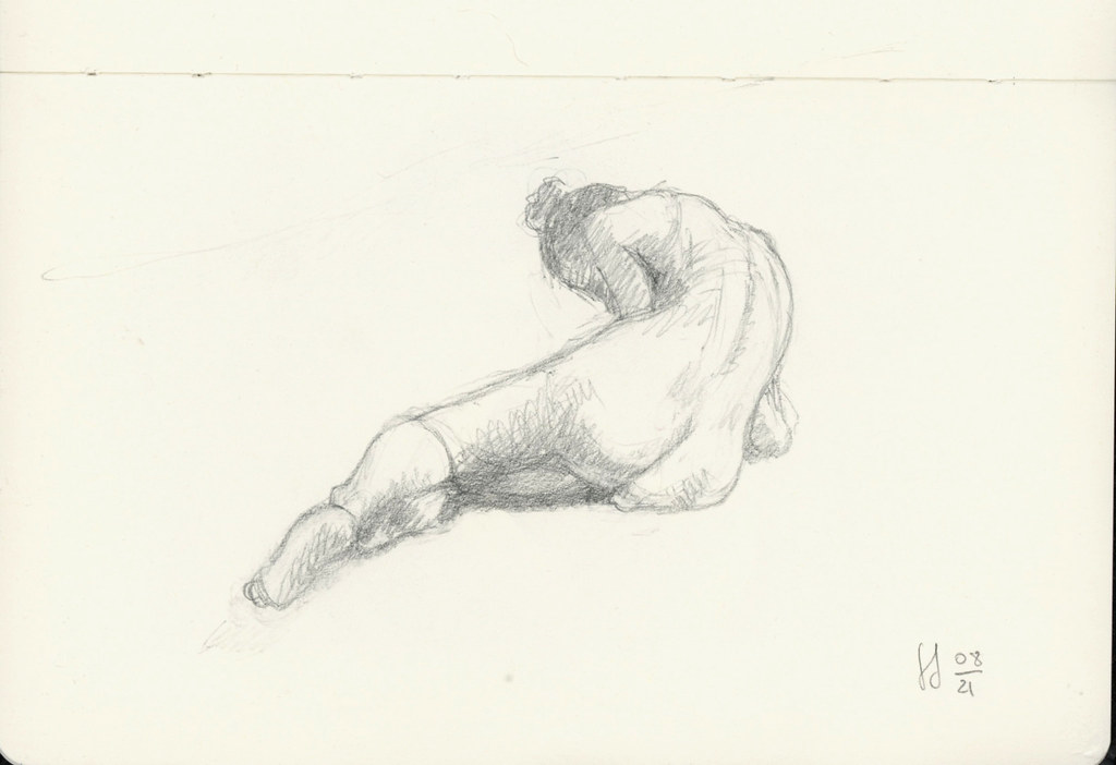 Nude laying, leaning on the elbow