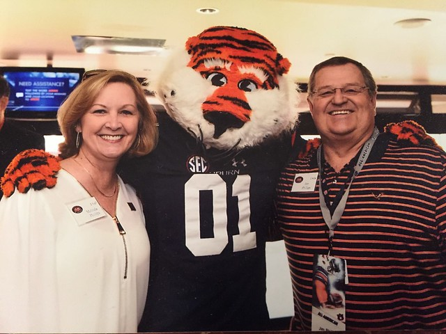 Dr. Jim Phillips with his wife, Melinda, and Aubie.