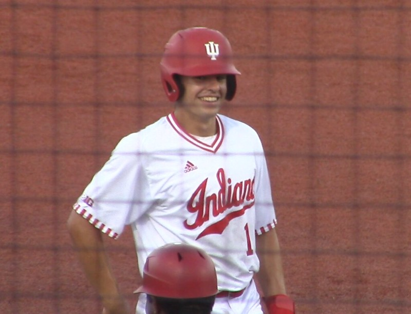 Indiana shortstop Phillip Glasser smiles at third base after hitting an RBI triple in game 2 against John A Logan CC
