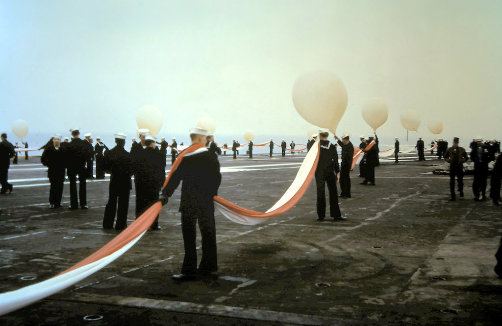 Photo by Donald Arata  1965 - USS Coral Sea CVA-43 shows its homecoming pennant upon returning to San Francisco.